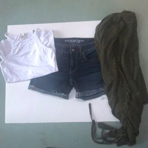 Jean shorts with green sweater and white tank top